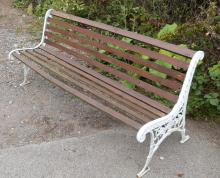 Two garden benches with iron ends