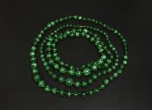 Three malachite bead necklaces, one with