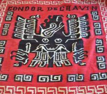 Peruvian wool rug in red with black imag