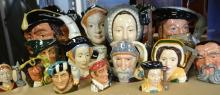 A collection of Doulton character jugs,