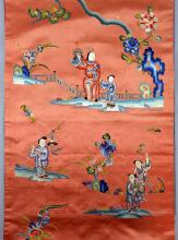 Chinese silk hanging, the red ground embroidered with figure