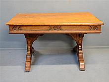 Oak Gothic Revival centre table on twin end supports with splayed legs