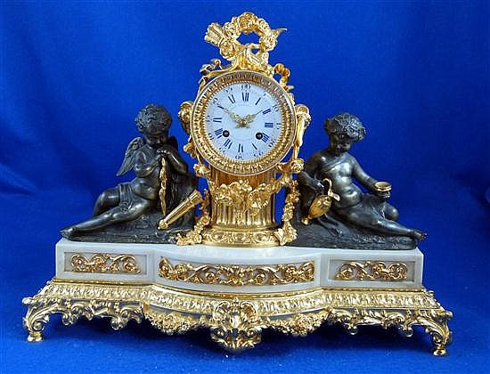 Grignon Meusnier, France circa 1830 - 1840, gilt and patinated bronze, and alabaster, eight-day mantel clock,
