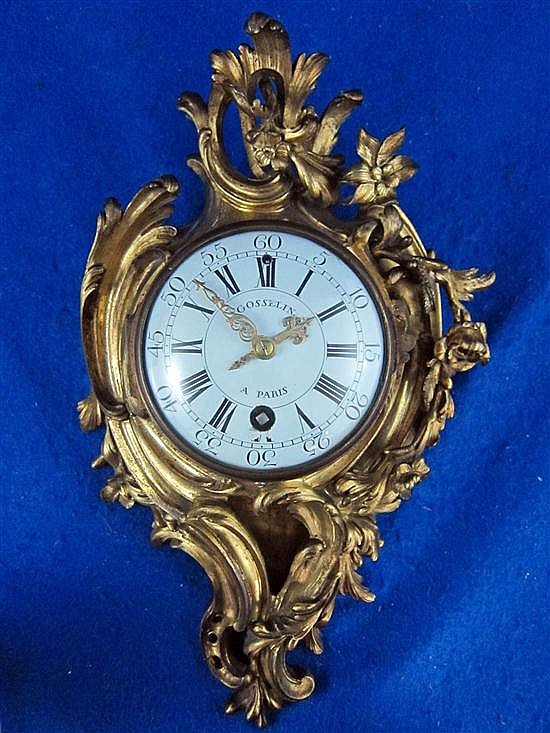 Nineteenth century French cartel clock, floral rococo style in bronze and gilded case,