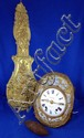 French comptoise clock by Besnard, enamel face, Roman numerals, eight day movement.