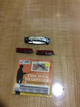 Pocket Knife Lot with 2 Swiss Army Knives another knife and a fish hook sharpener
