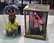 Two Collectible Dolls Under Glass