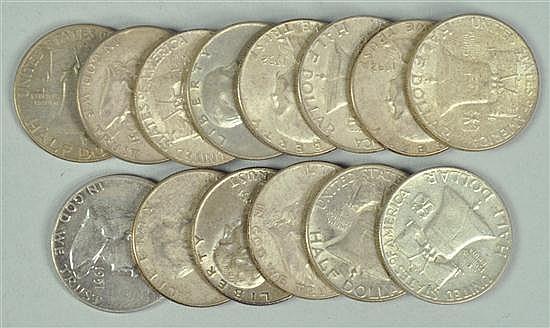 Fourteen Franklin Half Dollars