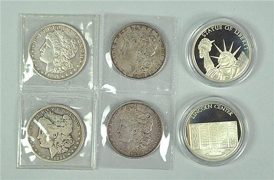 Four Morgan Dollars