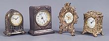 Four Metal Case Clocks