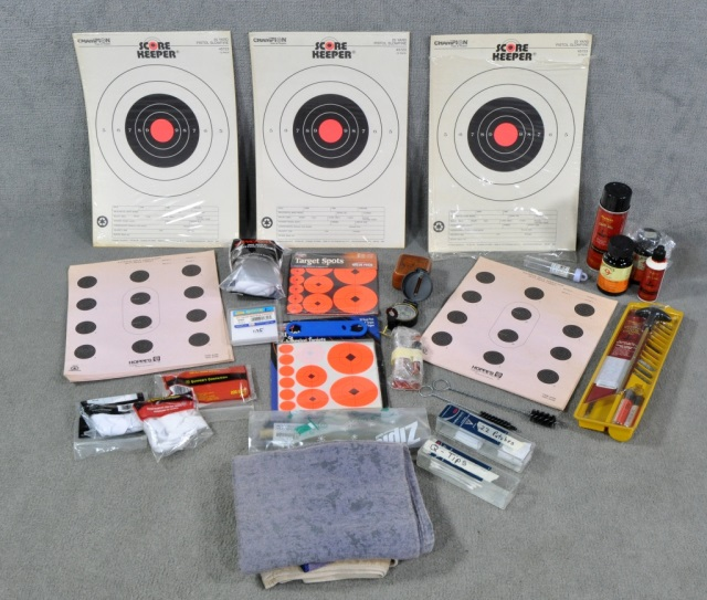 Box of Gun Cleaning Supplies and Paper Targets