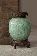 Théodore DECK (1823-1891)  Vase    Faïence émaillée céladon à décor floral en relief, monture en bronze doré japonisant, signé