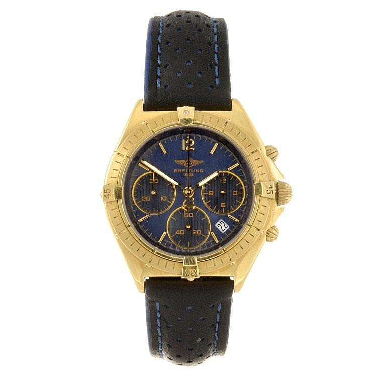 An 18k gold quartz gentleman's Breitling Chronomat wrist watch.