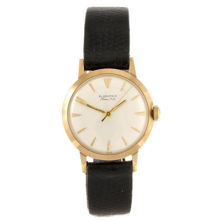 A 9ct gold manual wind gentleman's Blancpain wrist watch.