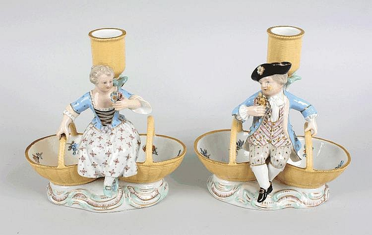 A pair of Meissen porcelain figural candlesticks