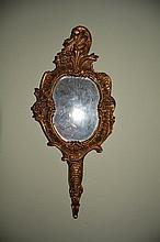 Hand mirror in a beautiful gold gilt frame