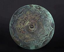 A bronze mirror China, Han (?) Dynasty