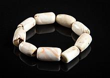 A fossilized shell necklace China/Tibet