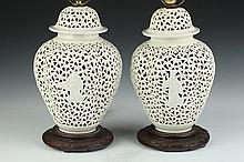 PAIR CHINESE BLANC-DE-CHINE RETICULATED QUATREFOIL VASES AND COVERS.