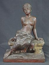 E. VILLAMIS, (19th Century), patinated spelter figure of a seated slave gir