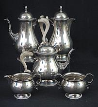 ELIZABETH II MATCHED FIVE PIECE SILVER TEA SET, comprising: teapot; coffeepot; water jug; cream jug