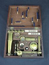 A CARY/GOULD TYPE LACQUERED BRASS PORTABLE MICROSCOPE marked Berge, Late Ramsden, London. In section