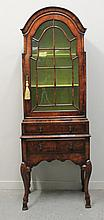 WILLIAM AND MARY STYLE WALNUT SINGLE DISPLAY CABINET having moulded arch top over single astragal gl