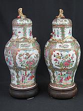 PAIR OF CHINESE CANTON PORCELAIN BALUSTER SHAPED LIDDED VASES, overall with Famille Rose painted dec