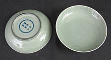 PAIR OF CHINESE PORCELAIN CELADON GLAZED SAUCER DISHES, each having incised floral decoration and wi