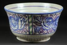 A large Carter, Stabler & Adams red earthenware Poole Pottery bowl, circular with gently flared rim, painted in blue and manganese with stylised circular flowers and tulips interspersed with 'barley twist' canes in green, impressed Carter Stabler mark, 25.5cm diameter approx.