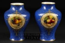 A pair of Royal Worcester squat baluster vases, signed C. Cresse, powder blue ground painted with reserves of fruit, shape no. 2491, date cipher for 1938, 10cm high (2)