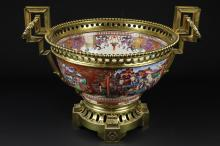 A Chinese porcelain punch bowl, famille rose mandarin palette, painted with figures within 'C' scroll mirror form cartouches, gilt metal neoclassical mounts, 41cm diameter max. including mounts