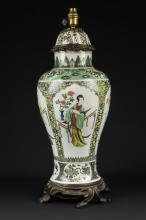 A Samson Chinese porcelain style vase & cover, painted in famille verte palette with figures within arched reserves on a yellow cell ground, gilt metal mounts, 52cm high