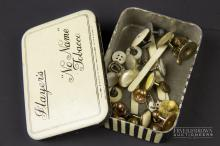 A small quantity of shirt studs, including a 10 carat gold filled example, contained in a vintage black & white striped Player's 'No Name' Tobacco tin (qty)