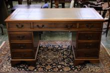 Walnut veneered pedestal desk, with green leather inset top, early 20thC