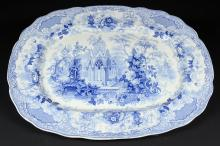A large Victorian blue & white transfer printed platter, decorated with figures in an ornate garden building amongst blooming flowers, probably Charles Meigh for Staffordshire, the base with printed mark 'Sicilian' and impressed Improved Stone China, 53 x 42.5cm approx.