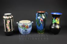A Crown Ducal lustre vase decorated with a parrot; a Lawleys Norfolk Pottery vase; and two other vases (4)
