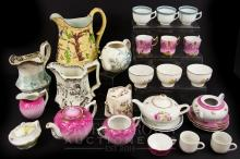 A group of child's part tea and dinner services, including English and Continental examples; together with three Staffordshire jugs (qty)