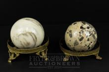 A 19th century marble sphere on gilt metal stand, 13cm diameter; and another marble sphere, similar