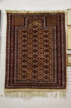 A prayer rug, possibly Afghan, labelled Maktabi, 125 x 96cm