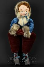 A Norah Wellings cloth face doll, dressed as an ice skater, with fur cuffs and bonnet, conjoined arms, 45cm max.