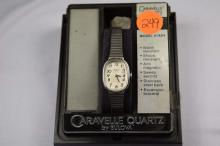 Watch, Caravelle mechanical wind by Bulova, Silver tone, Model 41A04, ladies watch, Water resistant, with expansion bracelet band,  White face with black letters.