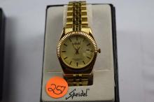 Watch, Speidel men's watch, quartz movement, gold tone case with gold face, gold slots, with date display, with bracelet band