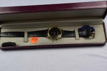 Watch, Belair, Gent's watch, gold tone, black face, with number slots, with black leather band, Swiss quartz movement
