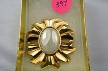 Broach, gold filled flower design with synthetic center stone