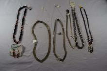 (8) various costume necklaces and (1) pair of earrings matching '