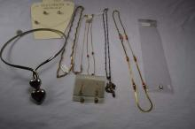 (8) various costume necklaces, (1) pair of earrings
