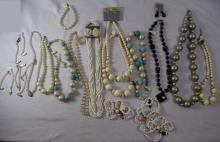 Costume jewelry; 12 necklaces, 10 bracelets, 4 sets of earrings, and 8-2