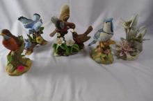Set of 4 porcelain bird figurines, including Robin and Hummingbird.  Tallest is about 6