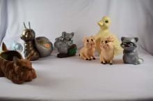 Set of 8 ceramic figurines, one large duck, large snail, two adorable little pigs, Blue bird chick, raccoon, koala bears, and brown terrier pup planter.  Tallest is about 8